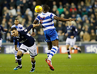 Lee Gregory of Millwall tangles with Nedum Onuoha of Queens Park Rangers during the Sky Bet Championship match between Millwall and Queens Park Rangers at The Den, London, England on 29 December 2017. Photo by Carlton Myrie / PRiME Media Images.