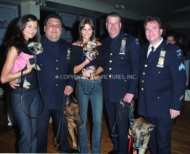 "Model MAY ANDERSEN and her dog ""Macumba"" (center) at the Westminster Kennel Club's Tea and Biscuits Benefit to honor the search and rescue dogs and their handlers who risked their lives at Ground Zero in the heroic efforts that took place following the World Trade Center tragedy. The American Park Restaurant in New York. February 6, 2002.  © 2002 by Alecsey Boldeskul/NY Photo Press.     ....*ONE-TIME REPRODUCTION RIGHTS*      ....NY Photo Press:  ..phone (646) 267-6913;   ..e-mail: info@nyphotopress.com"