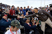 United States President Barack Obama greets veterans before the Carrier Classic basketball game between the University of North Carolina Tar Heels and Michigan State Spartans on the flight deck of the USS Carl Vinson, docked at North Island Naval Station in San Diego, California, November 11, 2011. .Mandatory Credit: Pete Souza - White House via CNP