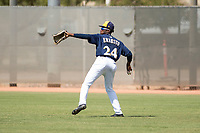 Milwaukee Brewers right fielder Larry Ernesto (24) throws to second base during an Instructional League game against the Los Angeles Dodgers at Maryvale Baseball Park on September 24, 2018 in Phoenix, Arizona. (Zachary Lucy/Four Seam Images)