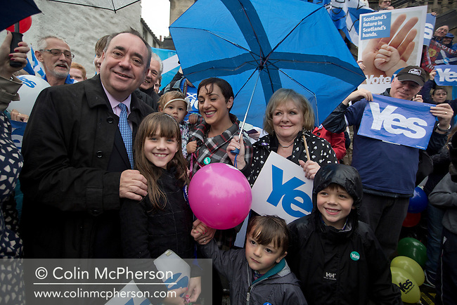 Scotland's First Minister Alex Salmond MSP, pictured with pro-independence supporters outside the Burgh Hall in his home town of Linlithgow, West Lothian. Salmond's visit was staged as part of the Yes Scotland campaign in the lead up to the referendum to decide whether the country should remain as part of the United Kingdom. On the 18th of September 2014, the people of Scotland voted in a referendum to decide whether the country's union with England should continue or Scotland should become an independent nation once again.