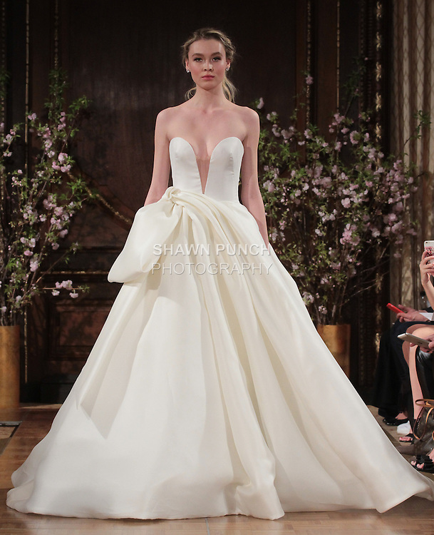 "Model walks runway in a ""Brett"" bridal gown from the Isabelle Armstrong Spring Collection 2017, at Lotte New York Palace Hotel, during New York Bridal Fashion Week Spring Summer 2017 on April 16, 2017."