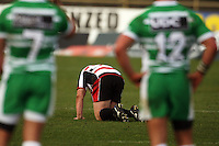 Counties hooker Matt Holloway stays down after a collision during the Air NZ Cup rugby match between Manawatu Turbos and Counties-Manukau Steelers at FMG Stadium, Palmerston North, New Zealand on Sunday, 2 August 2009. Photo: Dave Lintott / lintottphoto.co.nz