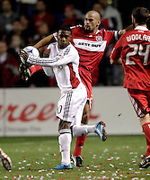 Real Salt Lake forward Robbie Findley (10) tries to avoid foot of Chicago Fire defender C.J. Brown (2).  Real Salt Lake defeated the Chicago Fire in a penalty kick shootout 0-0 (5-4 PK) in the Eastern Conference Final at Toyota Park in Bridgeview, IL on November 14, 2009.