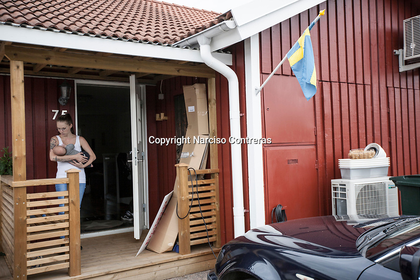 August 30, 2018: LIZ ZACHARIASSON, a 27 years-old member of the Swedish Democrats (Sverigedemokraterna) since 2009, holds her three-months-old baby at the porch of her house in the Ockelbo municipality. Liz is running for the Ockelbo municipality in the coming national elections in Sweden.