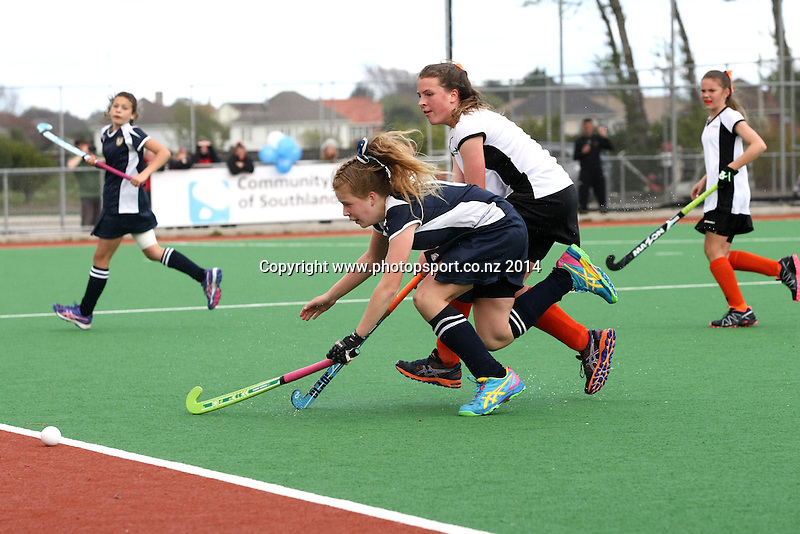Hawkes Bays Bella Greig, left, and Auckland's Sophie Giltrap compete for the ball in the U13 Collier Trophy Hockey Final, Invercargill, New Zealand, Saturday, October 11, 2014, Photo: Dianne Manson / www.photosport.co.nz
