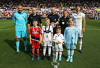 Children mascots with referee Lee Mason and team captains Heurelho Gomes of Watford (L) and Federico Fernandez of Swansea City (R) during the Premier League match between Swansea City and Watford at The Liberty Stadium, Swansea, Wales, UK. Saturday 23 September 2017