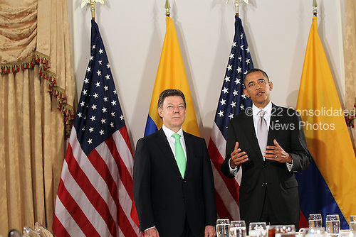 United States President Barack Obama (R) enters a bilateral meeting with President Juan Manuel Santos Calderon of Colombia, Friday, September 24, 2010 in New York City. Obama has been in New York since Wednesday attending the annual General Assembly at the United Nations, where yesterday he stressed the need for a resolution between Israel and Palestine, and a renewed international effort to keep Iran from attaining nuclear weapons..Credit: Spencer Platt - Pool via CNP