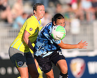 Abby Wambach #20 of the Washington Freedom, playing in a special camouflage uniform breaks away from Sara Larrson #7 of the Philadelphia Independence during a WPS match on military appreciation night at the Maryland Soccerplex in Boyds, Maryland on May 30 2010. Freedom won 2-1.