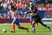 Atletico's Falcao and Granada's Brahimi during La Liga BBVA match. April 14, 2013.(ALTERPHOTOS/Alconada)