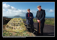 Blasket Islanders Muiris and Sean O'Guithin with a lobster pot they made.<br /> Picture: Don MacMonagle - macmonagle archive<br /> e: info@macmonagle.com