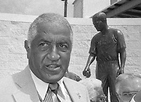 Don Newcombe, baseball great and team mate of baseball hall-of-famer Jackie Robinson, stands next to a statue of his late team mate at the dedication of the statue of Jackie Robinson outside the entrance to Jackie Robinson Ballpark, Daytona Beach, FL, October 1990.  (Photo by Brian Cleary/www.bcpix.com)