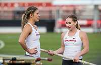 NWA Democrat-Gazette/BEN GOFF @NWABENGOFF<br /> Victoria Hoggard (left) and Desiree Freier of Arkansas talk between attempts Friday, April 12, 2019, during the women's pole vault at the John McDonnell Invitational at John McDonnell field in Fayetteville. Hoggard won the even with Freier in second place.
