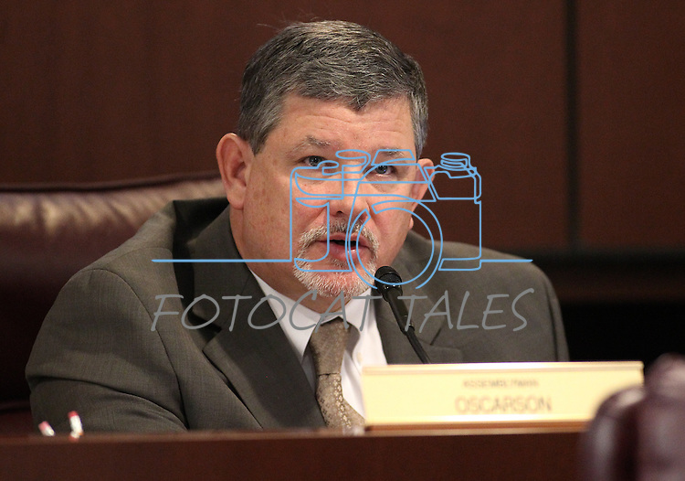 Nevada Assemblyman James Oscarson, R-Pahrump, works in committee at the Legislative Building in Carson City, Nev., on Friday, March 20, 2015. <br /> Photo by Cathleen Allison