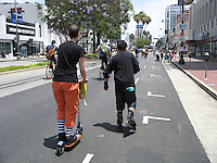 Michelle on her Go-Ped Know-Ped kick scooter and George on rollerblades along Wilshire Blvd. during during the June 23, 2013 CicLAvia event, where miles of Wilshire Blvd. were closed to car traffic.  Taken near the Korean Cultural Center (just west of Dunsmuir Ave.).