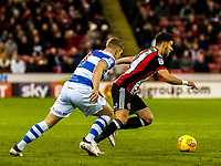 Sheffield United's defender George Baldock (2) takes on Queens Park Rangers defender Jake Bidwell (3) during the Sky Bet Championship match between Sheff United and Queens Park Rangers at Bramall Lane, Sheffield, England on 20 February 2018. Photo by Stephen Buckley / PRiME Media Images.