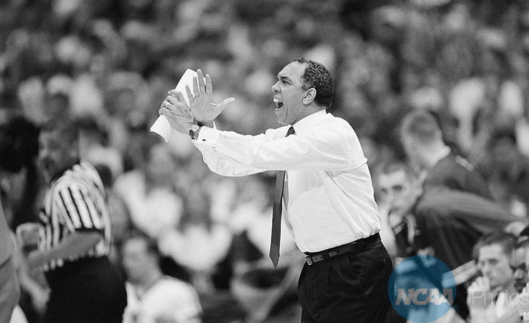 Caption: 30 MAR 1998: Kentucky head coach Tubby Smith shouts instructions to his Wildcat players during the Division 1 Men's Basketball Championship held at the Alamodome in San Antonio, TX. The Kentucky Wildcats defeated the Utah Utes 78-69 to claim the Championship title. Brian Gadbery/NCAA Photos.
