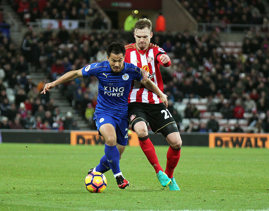 Leicester City's Shinji Okazaki holds off the challenge from Sunderland's Jan Kirchhoff<br /> <br /> Photographer Rich Linley/CameraSport<br /> <br /> The Premier League - Sunderland v Leicester City - Saturday 3rd December 2016 - Sunderland Stadium of Light - Sunderland<br /> <br /> World Copyright &copy; 2016 CameraSport. All rights reserved. 43 Linden Ave. Countesthorpe. Leicester. England. LE8 5PG - Tel: +44 (0) 116 277 4147 - admin@camerasport.com - www.camerasport.com