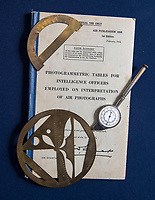 BNPS.co.uk (01202 558833)<br /> Pic: PhilYeomans/BNPS<br /> <br /> Tools of his trade - In a world without computors Flt Lt Cooper used complicated mathematics to find and plot targets.<br /> <br /> Unearthed - fascinating unseen archive of cameras, photographs, documents and medals from a British aerial reconnaisance expert who fought all the way through Africa and southern Europe in WW2.<br /> <br /> Flt Lt Eric Cooper from London kept all his wartime paraphernalia, including his K20 handheld camera and stereoscopic plotting instruments until his death in Devon aged 96 in 2012.<br /> <br /> The incredible photographs show bombing raids, amphibious landings and badly damaged aircraft alongside off duty snaps of the campaign throughout the mediterraenean.<br /> <br /> His nephew is now selling the compelling collection at Plymouth Auction Rooms in Devon next week.