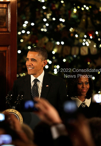 United States President Barack Obama, and first lady Michele Obama arrive for the Hanukkah Reception in the Grand Foyer of the White House  in Washington DC, on December 13, 2012..Credit: Aude Guerrucci / Pool via CNP
