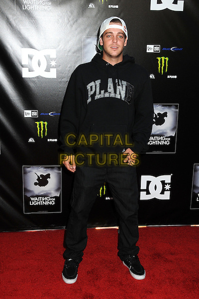 "Ryan Sheckler.""Waiting For Lightning"" Los Angeles Screening held at The Cinerama Dome, Hollywood, California, USA..April 10th, 2012.full length sweatshirt top jeans denim black white baseball cap hat backwards stubble facial hair plan b.CAP/ADM/BP.©Byron Purvis/AdMedia/Capital Pictures."
