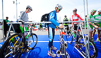 24 APR 2011 - NICE, FRA - Javier Gomez (Sartrouville) (centre) racks his bike in transition between those of team mates Alistair Brownlee (left) and Jonathan Brownlee (right) before the start of the first round of the 2011 French Grand Prix triathlon series .(PHOTO (C) NIGEL FARROW)