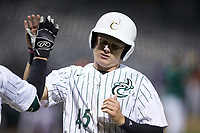 Austin Lynch (45) of the Charlotte 49ers high fives a teammate as he scores a run during the game against the Clemson Tigers at BB&T BallPark on March 26, 2019 in Charlotte, North Carolina. The Tigers defeated the 49ers 8-5. (Brian Westerholt/Four Seam Images)