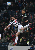 Kelvin Wilson beats John McGinn in the air in the St Mirren v Celtic Scottish Communities League Cup Semi Final match played at Hampden Park, Glasgow on 27.1.13.