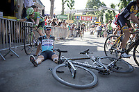 Tony Martin (DEU/Ettix-Quickstep) put in a very strong climb up the infamous steep Mur de Huy and collapses immediately after the finish line<br />