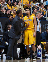 California associate head coach Travis DeCuire talks with Justin Cobbs during the game against Arizona at Haas Pavilion in Berkeley, California on February 1st, 2014.  California Golden Bears defeated Arizona Wildcats, 60-58.