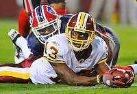 Redskins WR Anthony Armstrong (13) gets huge eyes after seeing the referee signal touchdown after Armstrong caught a pass, fought past Bills DB Terrence McGee (24),  and stretched the ball across the goal line for his first NFL touchdown.  The Washington Redskins defeated the Buffalo Bills 42-17 during their preseason game at FedEx Field in Landover, MD.