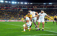 Victor Vito tackles Anton Lienert-Brown during the Super Rugby semifinal match between the Hurricanes and Chiefs at Westpac Stadium, Wellington, New Zealand on Saturday, 30 July 2016. Photo: Dave Lintott / lintottphoto.co.nz