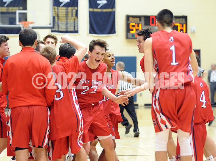 Holy Ghost players , led by john McCrane #22, celebrate after defeating Lower Moreland 74-54 to win the District One Class AAA boys basketball championship game Saturday February 27, 2016 at Council Rock South in Northampton, Pennsylvania. (Photo by William Thomas Cain)