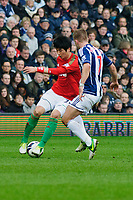Saturday, 9 March 2013<br /> <br /> Pictured: Ki Sung-Yueng of Swansea City is tackled by James Morrison of West Bromwich Albion<br /> <br /> Re: Barclays Premier League West Bromich Albion v Swansea City FC  at the Hawthorns, Birmingham, West Midlands