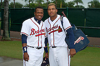 GCL Braves outfielder Jose Morel (55) and infielder Robinson Arno (26) pose for a photo after a game against the GCL Blue Jays on July 15, 2013 at Disney's Wide World of Sport in Orlando, Florida.  The game was called in the 4th inning due to rain storms with the Braves leading 5-0.  (Mike Janes/Four Seam Images)