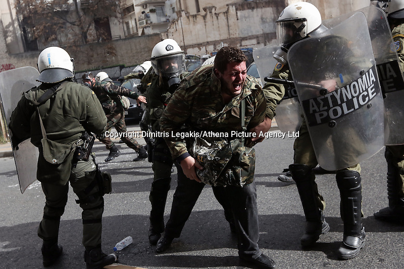 Pictured: A farmer is placed under arrest by riot police officers Friday 12 February 2016<br /> Re: Violent clashes between farmers and riot police outside the Ministry of Agricultural Development in Athens, Greece. The farmers travelled from Crete to protest against pension and welfrae reforms proposed by the Greek government,