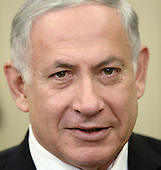 Prime Minister Benjamin Netanyahu of Israel speaks to the press in the Oval Office of the White House prior to a meeting with United States President Barack Obama, Wednesday, October 1, 2014 in Washington, DC.  <br /> Credit: Olivier Douliery / Pool via CNP