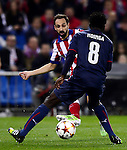 Juanfran Torres vies with Ndinga during the UEFA Champions League semifinal first leg football match Club Atletico de Madrid vs Olympiacos at the Vicente Calderon stadium in Madrid on November 26, 2014.   PHOTOCALL3000/ DP