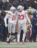 Ohio State Buckeyes defensive back Vonn Bell (11) and Ohio State Buckeyes safety Tyvis Powell (23) against Minnesota Golden Gophers at TCF Bank Stadium in Minneapolis, Minn. on November 15, 2014.  (Dispatch photo by Kyle Robertson)