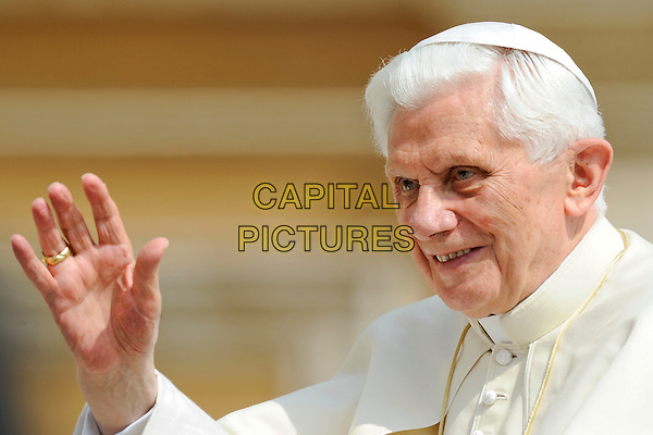 POPE BENEDICT XVI (Joseph Aloisius Ratzinger).Pope Benedict XVI presided at the general audience in St Peter's Square in front of thousands of faithful, Vatican City,.May 4th, 2011.religion religious catholic holy faith gv general view headshot portrait white robe cap rear crowds hand waving .CAP/EPS/GG.©Giuseppe Giglia/EPS/Capital Pictures