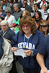 "Heidi Englund, right, sings on the Capital steps Thursday, Oct. 30, 2014 during #NevadaSings!, a statewide sing-a-long of ""Home Means Nevada."" Approximately 370 people took part  in the Carson City portion of the event, which seeks to establish a new record for the most people in an American state to sing their state song at the same time."