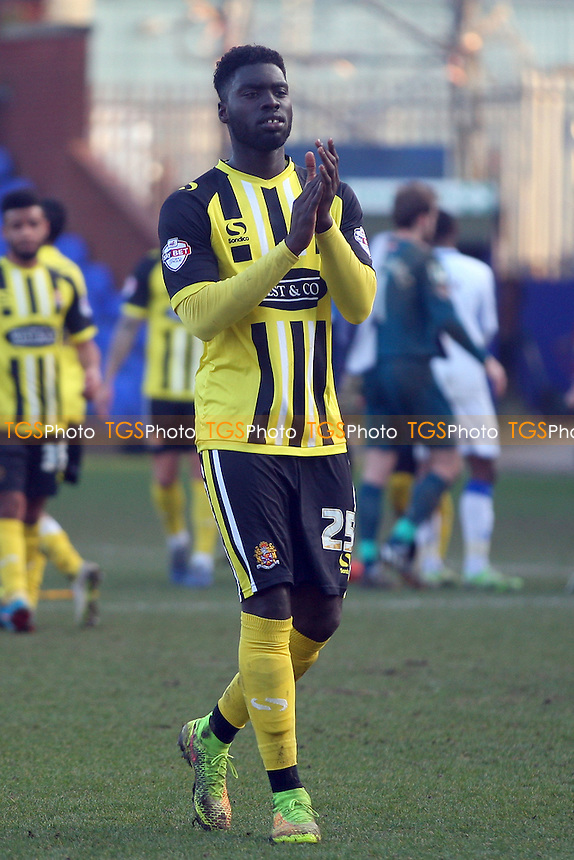 Ayo Obileye of Dagenham and Redbridge claps the away fans at the end of the game - Tranmere Rovers vs Dagenham and Redbridge - SkyBet League Two football at the Prenton Park Stadium on  07/03/15 - MANDATORY CREDIT: Dave Simpson/TGSPHOTO - Self billing applies where appropriate - 0845 094 6026 - contact@tgsphoto.co.uk - NO UNPAID USE