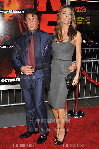"Sylvester Stallone & wife Jennifer Flavin at the premiere of ""Red"" at Grauman's Chinese Theatre, Hollywood..October 11, 2010  Los Angeles, CA.Picture: Paul Smith / Featureflash"