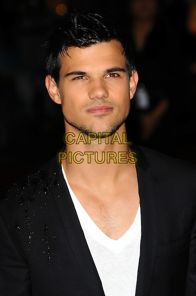 Taylor Lautner.The European Premiere of 'Abduction', BFI Imax, London, England..26th September 2011.headshot portrait black white stubble facial hair .CAP/CJ.©Chris Joseph/Capital Pictures.