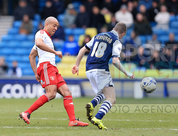 Millwall's Shane Ferguson tussles with Sheffield United's Alex Baptiste during the League One match at The Den.  Photo credit should read: David Klein/Sportimage