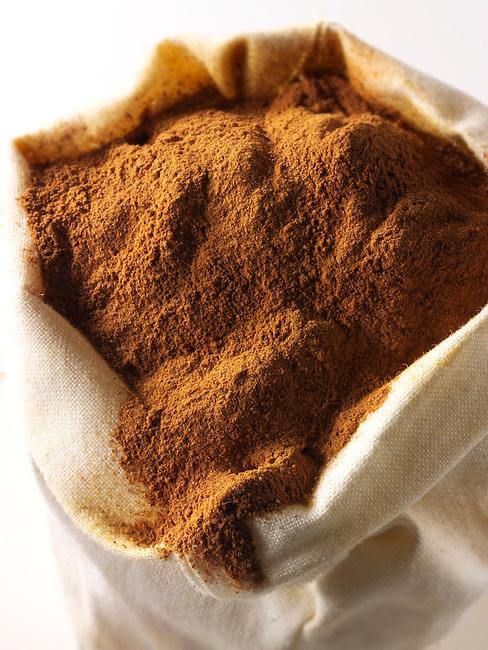 Ground Cinnamon Powder - stock photo
