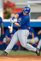Pulaski Blue Jays right fielder Travis Snyder (34) makes contact with the ball versus the Burlington Indians at Burlington Athletic Park in Burlington, NC, Saturday, July 29, 2006.  The Indians defeated the Blue Jays by the score of 8-4.