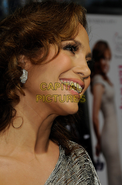 "JENNIFER LOPEZ .arriving at the premiere of CBS Films' ""The Back-up Plan"" at the Regency Village Theatre in Westwood, California, USA, April 21st, 2010..arrivals portrait headshot one shoulder silver earring wavy hair  profile side smiling .CAP/ROT.©Lee Roth/Capital Pictures"