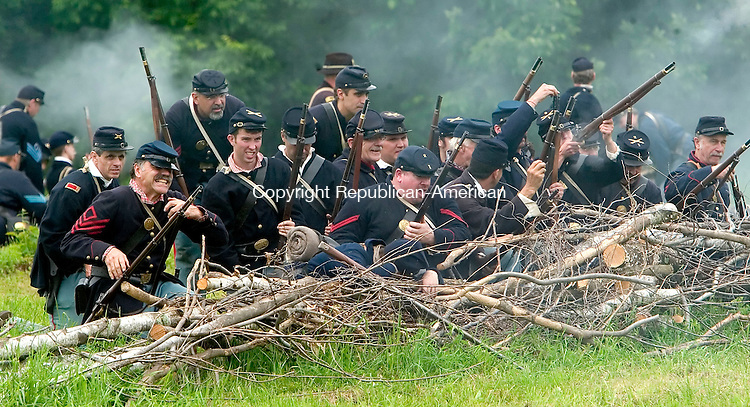 GOSHEN, CT--17 JUNE 2006 -061706JS39- Union troops engage the Confederate soldiers during the 'Battle at Wadham's Grove' during the Civil War encampment in Goshen. The reenactment depicts the Jackson Valley Campaign.  -- Jim Shannon Republican-American