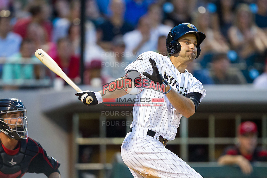 Jordan Danks (20) of the Charlotte Knights follows through on his swing against the Rochester Red Wings at BB&T Ballpark on June 5, 2014 in Charlotte, North Carolina.  The Knights defeated the Red Wings 7-6.  (Brian Westerholt/Four Seam Images)